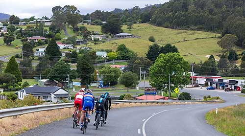 Road cyclists riding into Branxholm, North East Tasmania