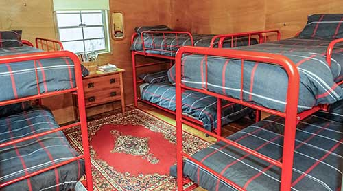 Six bunk-style beds in the Settlers Hut